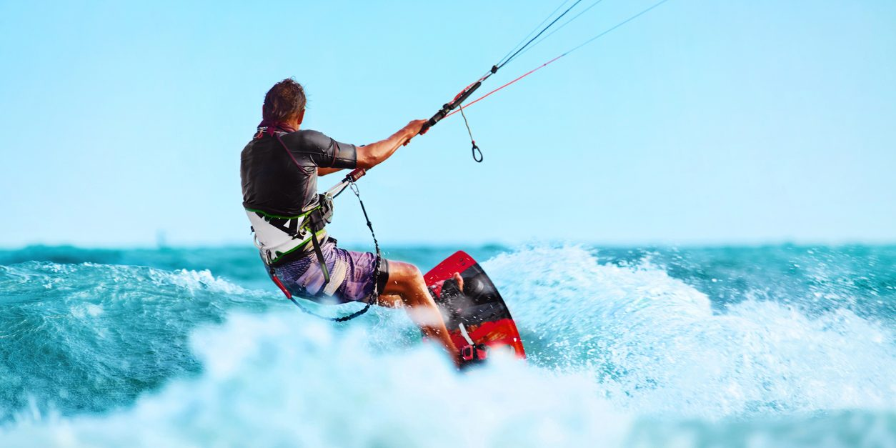 Kiteboarding, Kitesurfing. Water Sports. Professional Kite Surfer In Action On Waves In Ocean. Extreme Sport. Healthy Active Lifestyle. Hobby. Recreational Sporting Activity. Summer Fun, Adventure